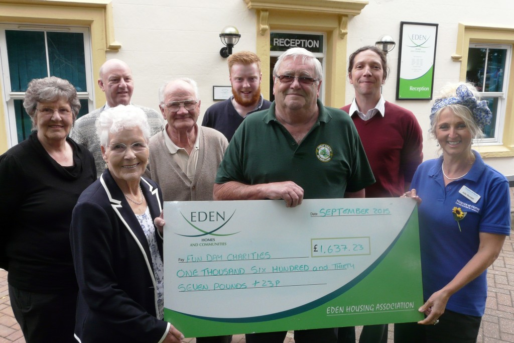 Presenting the cheque to charities at Eden Housing Association office